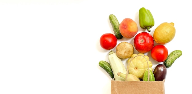 Shopping online delivery service concept vegetables fruits paper bag tomato cucumber squa