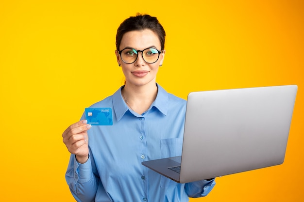 Shopping online. female holding laptop and choosing things to buy.