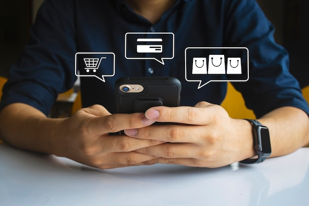 Shopping online men hand holding texting using mobile