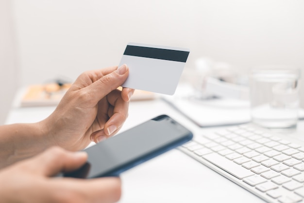 Shopping online with a credit card and smartphone