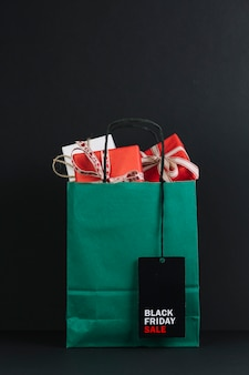 Shopping packet with present boxes with sale tag