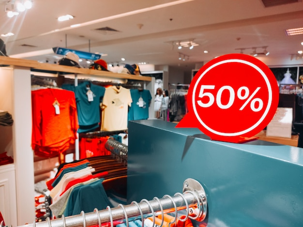 Shopping sale t-shirts -50% discount. sales in the male and female closing section (shirts). horizontal copyspace