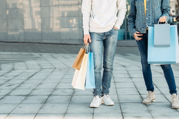 Shopping time casual leisure of urban couple man and woman with paper bags