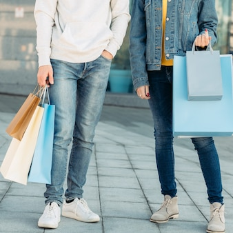 Shopping time casual leisure of urban family man and woman with paper bags