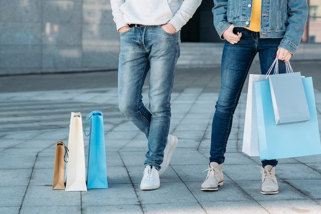Shopping time couple casual leisure man and woman with paper bags