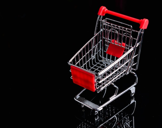 Shopping trolley or cart on black background