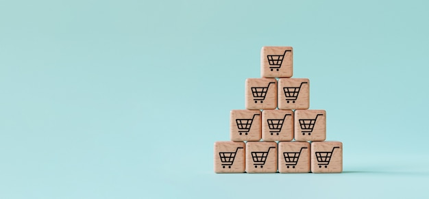 3dレンダリングによる販売量と注文増加の概念の増加の兆候のための青い背景に積み重ねられた木製の立方体ブロック上のショッピングトロリーカートの印刷画面。