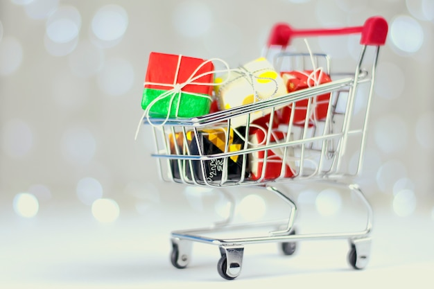 Shopping trolley filled with christmas gifts