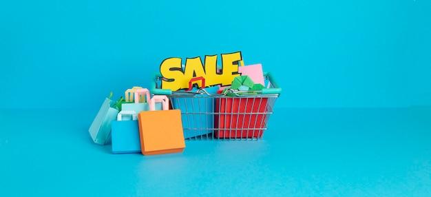 紙袋でいっぱいのショッピングカートショッピング中毒の概念