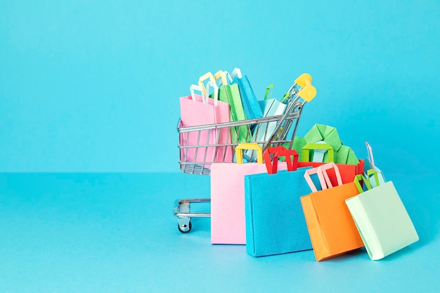 Shopping trolley full of paper bags shopping addiction concept
