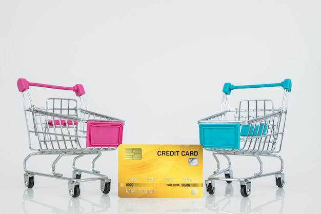Shopping trolley models with the credit card. e-commerce shopping.