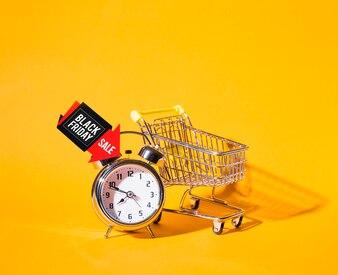 Shopping trolley near alarm clock