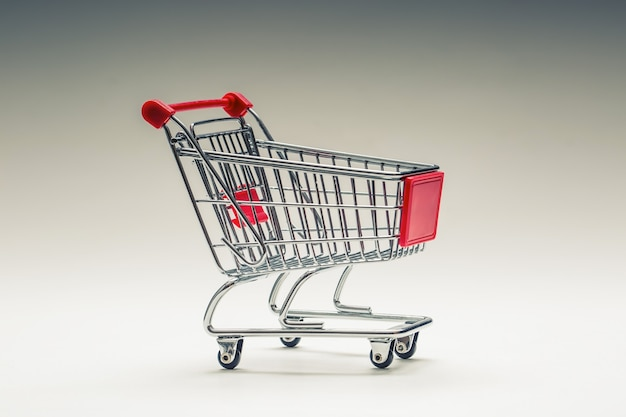 Shopping trolley or shopping cart shopping trolley on multi collored background