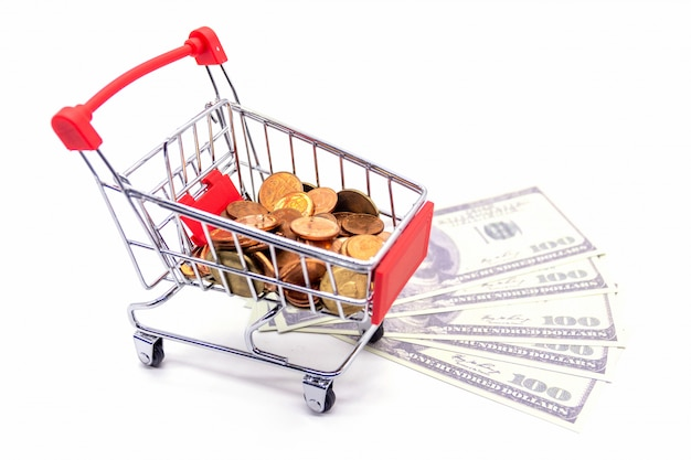 Shopping trolley with dollars on white