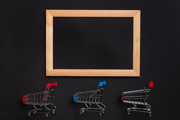 Shopping trolleys with red and blue handles and photo frame