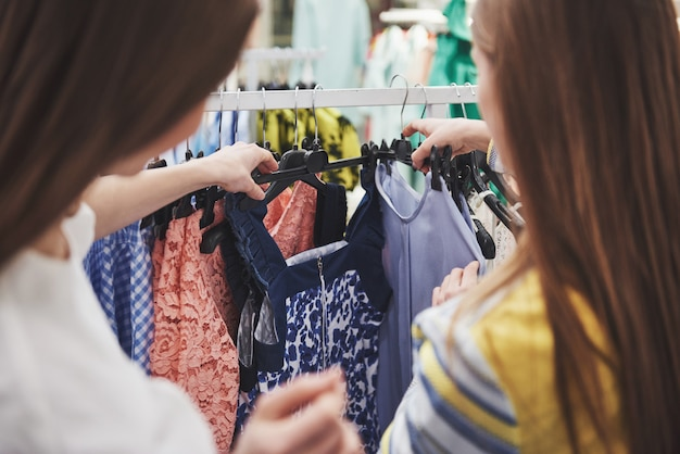 Shopping with bestie. two women shopping in retail store. close up view