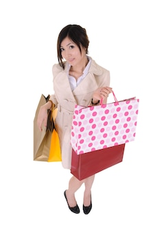 Shopping woman holding colorful bags