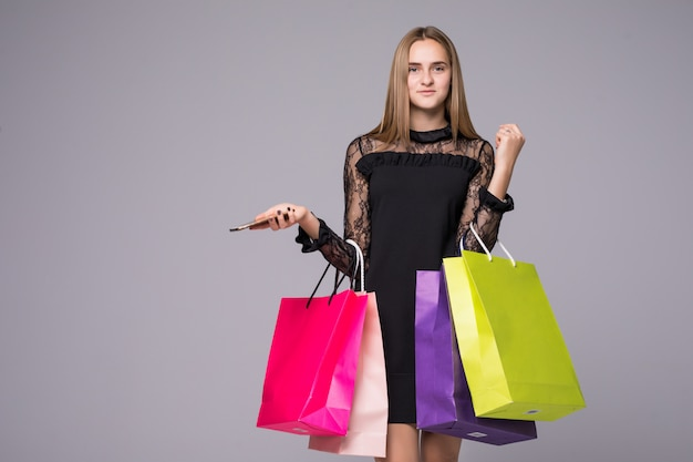 Shopping woman smiling holding small shopping bags