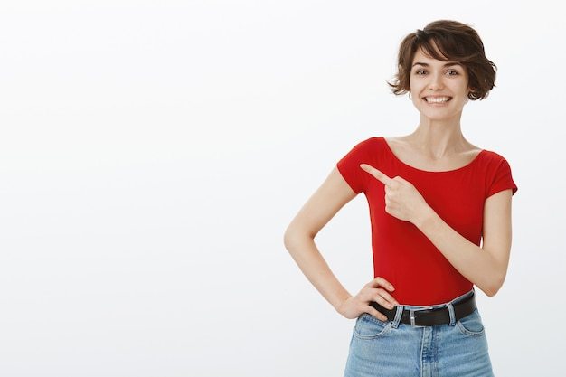 Short hair girl posing in red tshirt