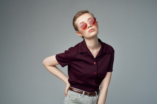 Short haired woman in a red shirt classic style isolated background