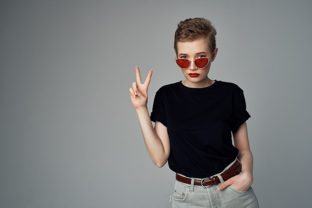 Short haired woman with sunglasses fashion dark background