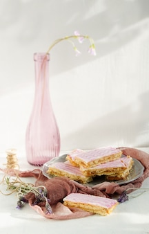 Shortbread bars, glazed with sugar icing with lavender