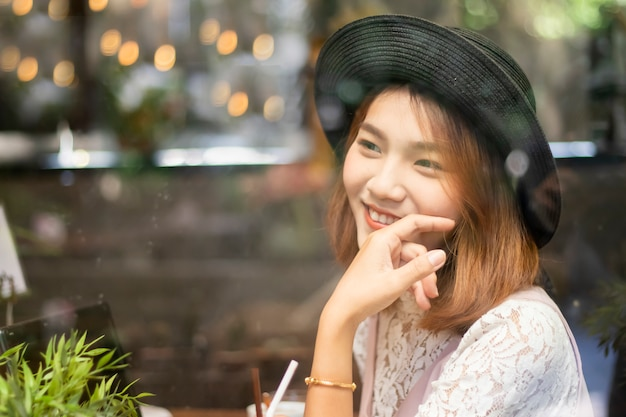 A shot of a beautiful asian woman  in a cafe