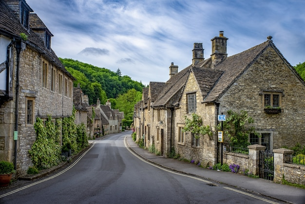 Shot of brick stone houses on the main street castle combe, uk