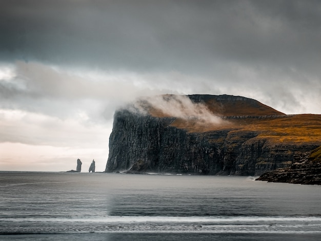 Shot capturing the beautiful nature of the faroe islands, sea, mountains, cliffs