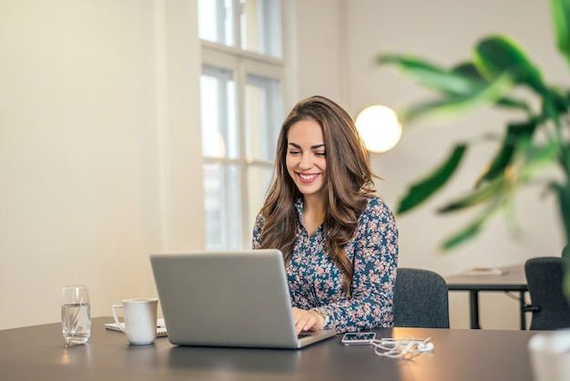 Shot of an executive businesswoman working on her laptop in office.