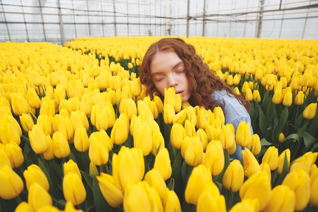 Shot of lying on flowers woman