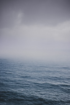Shot of the ocean on a foggy day