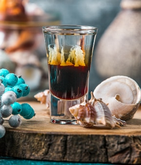 Shot of ombre drink decorated with shells