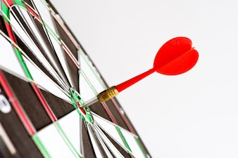 Shot red darts arrows in the target center. Business target or goal success concept.
