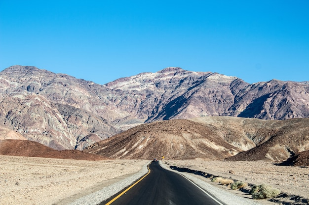 Shot of a  road  near the massive mountains in death valley national park, california usa