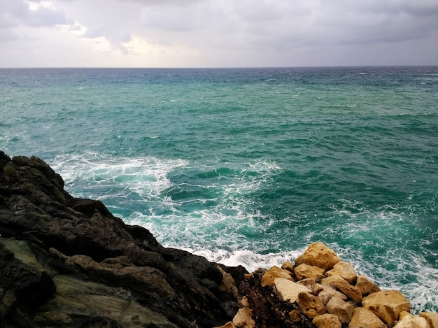 Shot of the rocky shore in fuerteventura, spain during cloudy weather