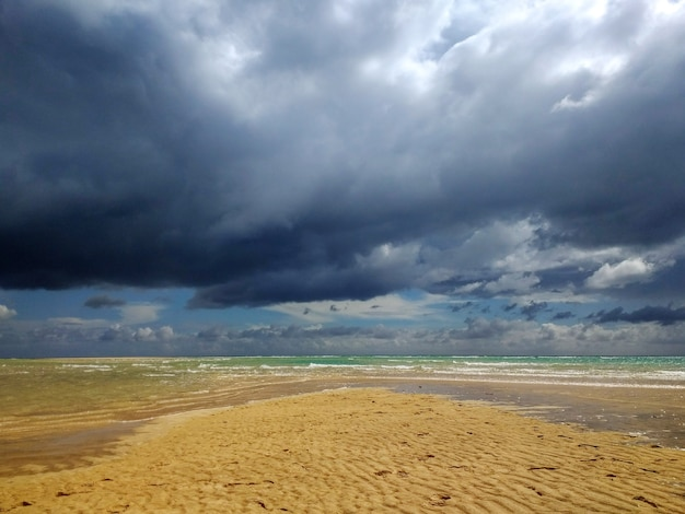 Shot of the sandy beach in fuerteventura, spain during stormy weather
