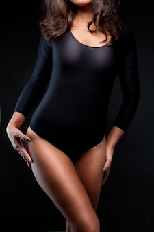 Shot of a sexy woman in black lingerie on black