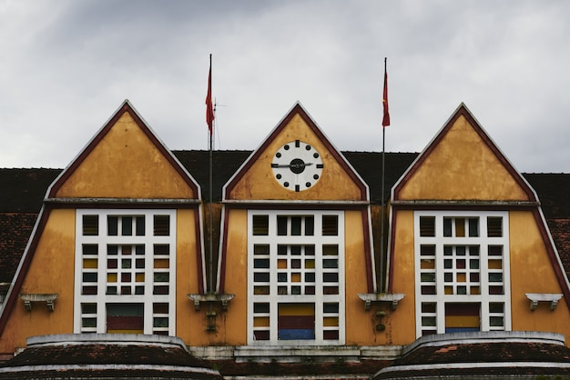Shot of the train station roof with clocks showing quarter to three