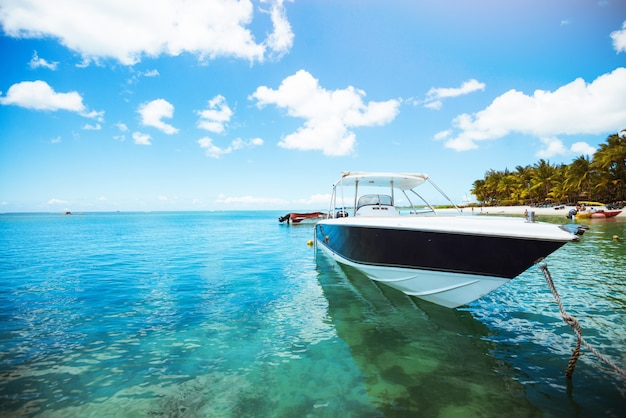Shot of yacht on crystal water. tropical island. voyage concept