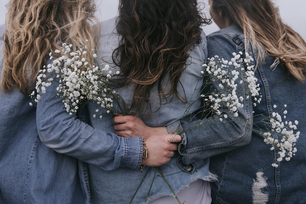 Behind shot of young girls with flowers