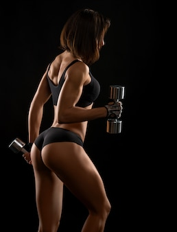 Shots of a fit female with dumbbells