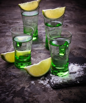 Shots of mexican silver tequila with lime and salt. selective focus