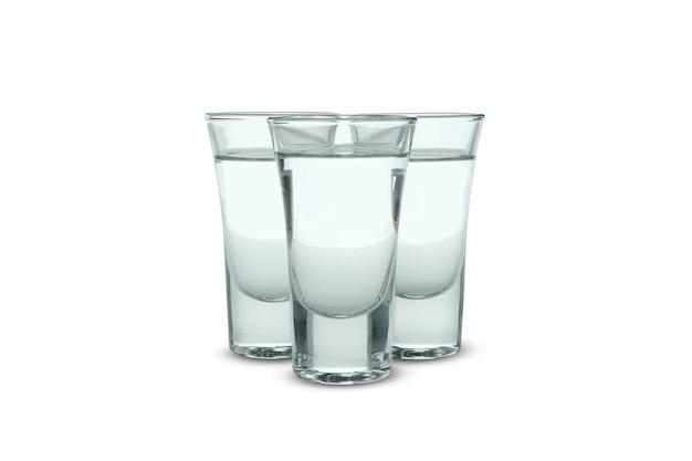Рюмки водки или текилы на белом