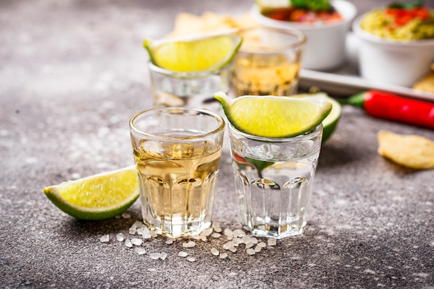 Shots of silver and gold tequila