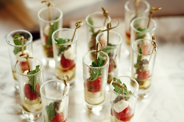 Shots with fruits on sticks stand on the table