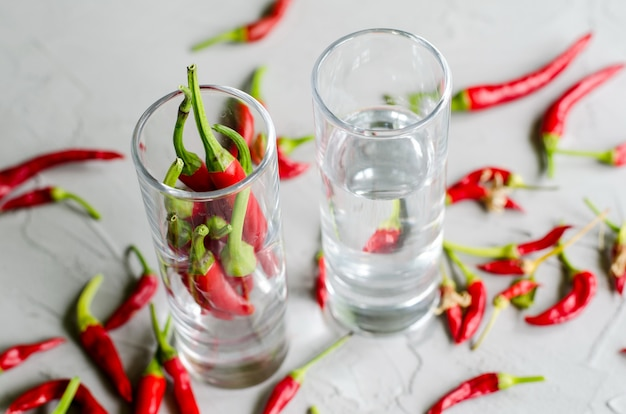 Shots with vodka and chilly peppers, hot alcoholic drink