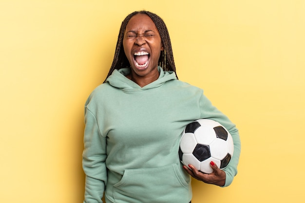 Shouting aggressively, looking very angry, frustrated, outraged or annoyed, screaming no. soccer concept