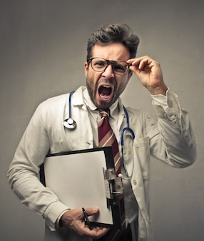 Shouting angry young doctor