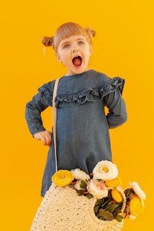Shouting girl wearing flower basket